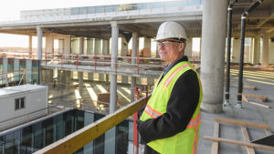 Jim Oliver looks over the construction progress